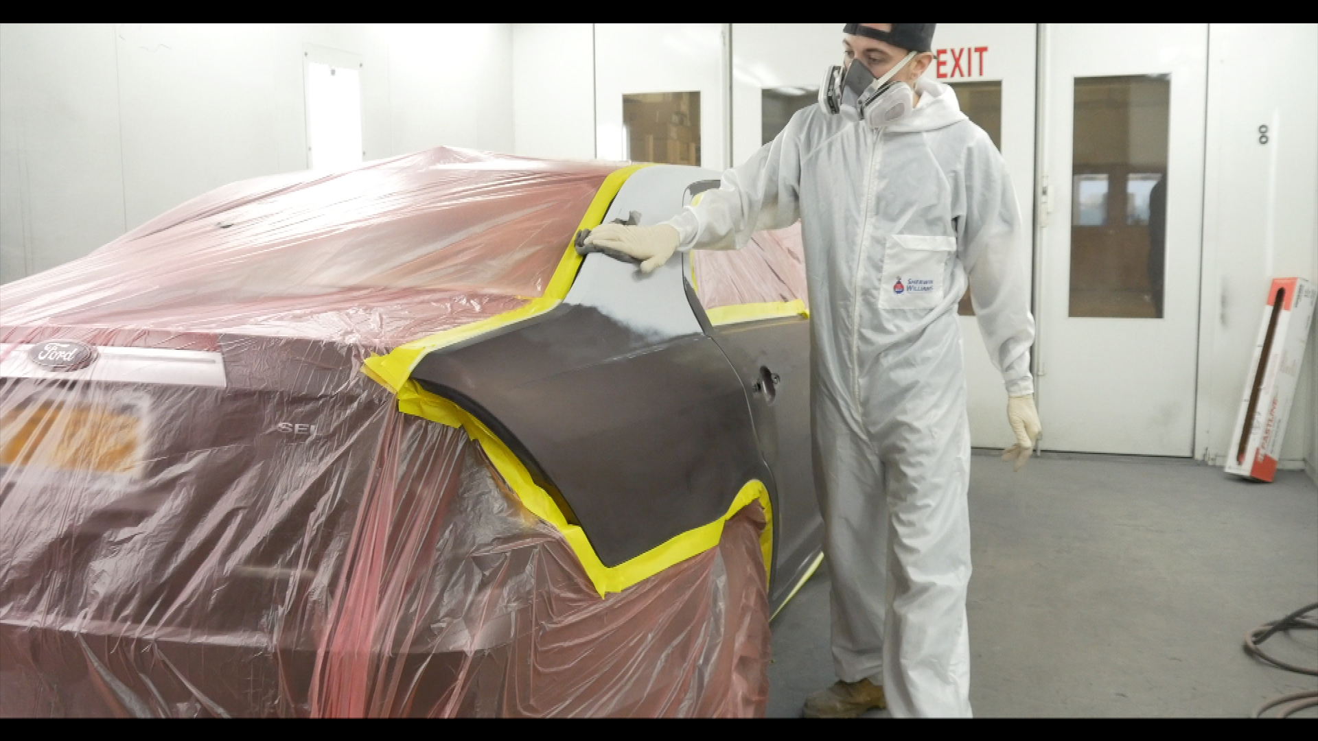 Spray painting a car